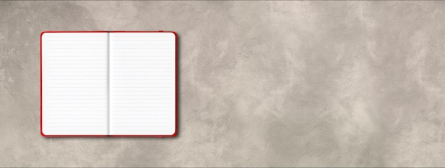 Red open lined notebook mockup isolated on concrete background. horizontal banner