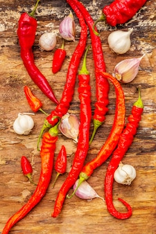 Red and orange chili pepper with garlic cooking