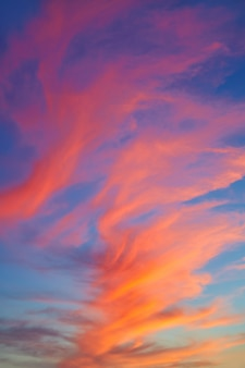 Red orange clouds at sunset over blue