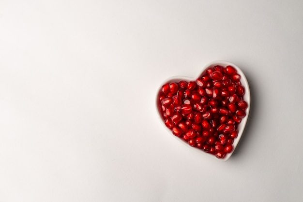 Red organic tasty pomegranate seeds with love
