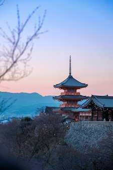 Red pagoda in twilight at kiyomizu dera,japan