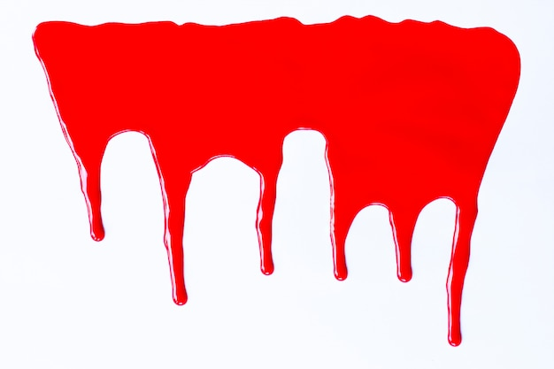 Red paint dripping on a white.