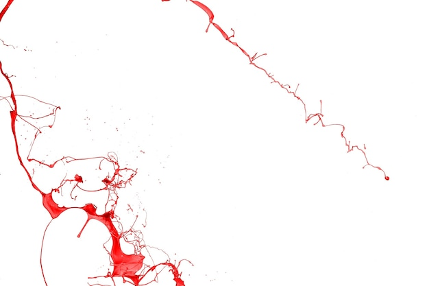 白い背景で隔離の赤いペンキのスプラッシュ