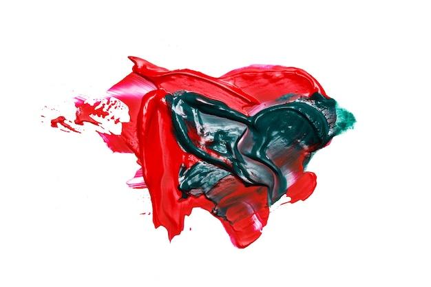 白い背景に分離された赤いペンキの汚れ