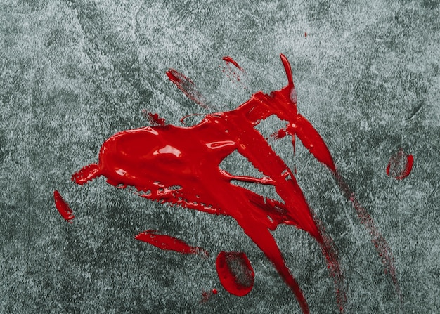 Red paint on stone surface