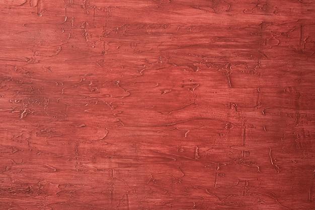 Красная краска текстуры фона.