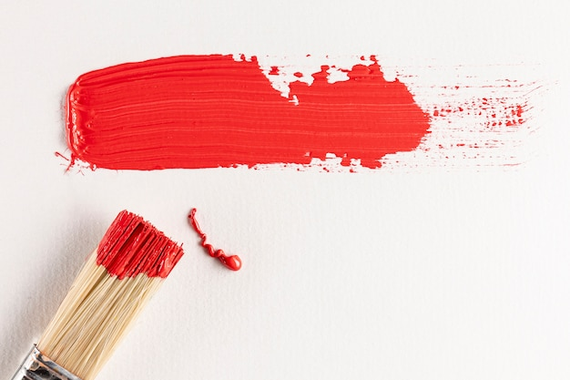 Red paint trail with brush