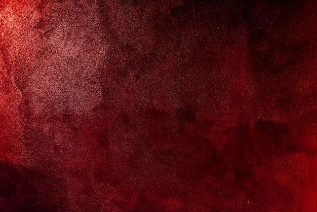 赤いペイントの壁の背景のテクスチャ
