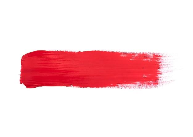 白で隔離される赤い絵筆ストローク