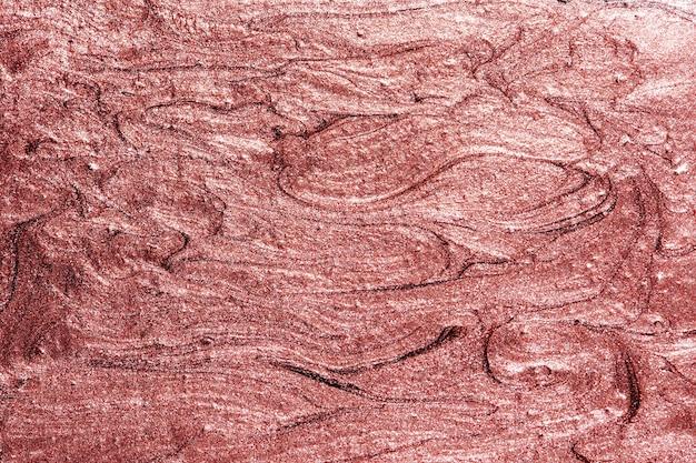 赤く塗られた織り目加工の壁の背景