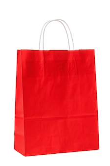 白い背景で隔離の赤い紙袋