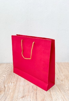 Red paper bag isolated on white