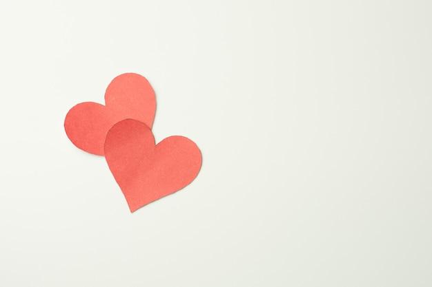 Red paper broken heart on white background