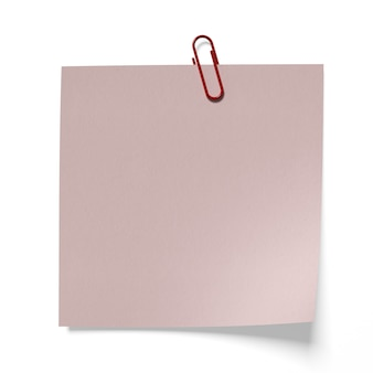 고립 된 분홍색 종이에 빨간 종이 클립