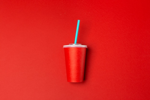Red paper cup isolated on red,