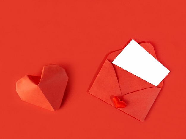 Red paper envelope with a note for valentine's day on a white