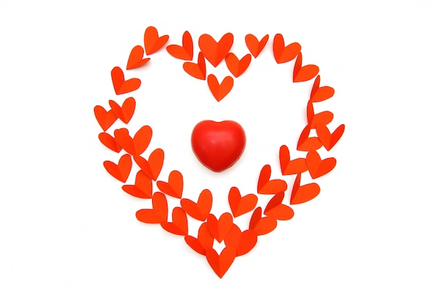 Red paper and heart rubber in heart shape in white background, valentine day concept.