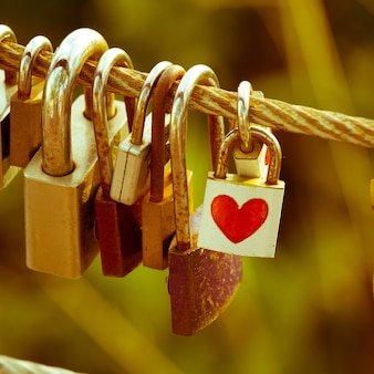 Red paper hearts valentines day stick on padlock