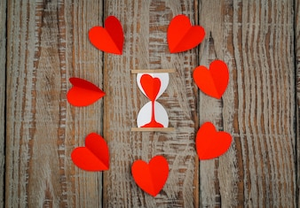 Red paper origami heart  on wood background .