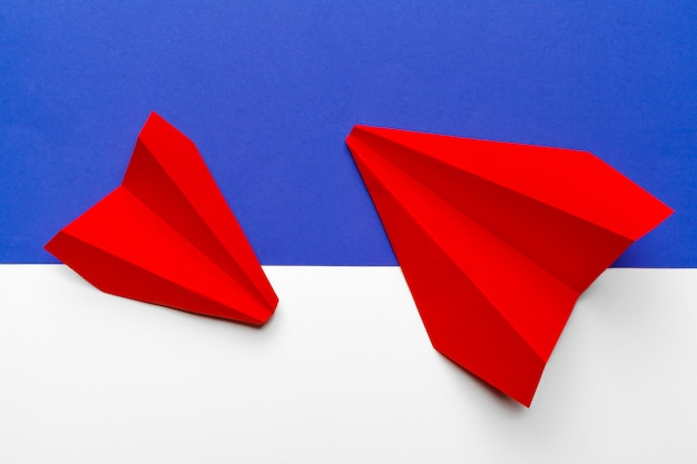 Red paper origami plane. transportation and business concept