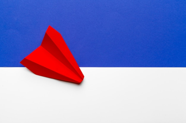 Red paper origami plane. transportation and business
