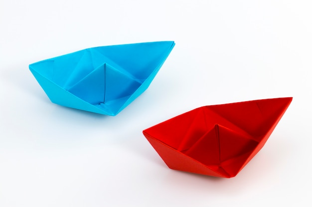 Red paper ship and blue paper ship