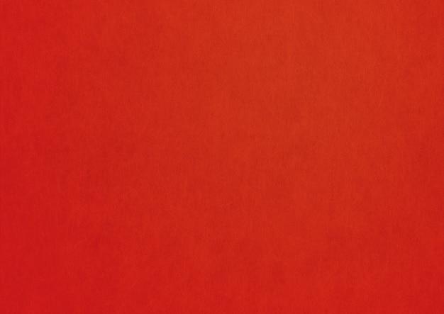 赤い紙のテクスチャの背景。きれいな空白の壁紙