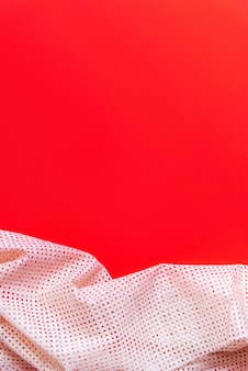 Red paper texture and light fabric frame.