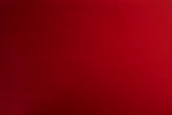 赤い紙の質感または背景