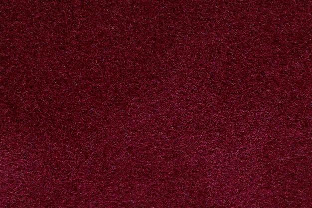 赤い紙のテクスチャ、聖バレンタインデーの背景。高解像度の写真。