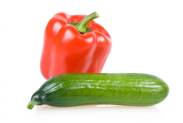 Red paprika and cucumber vegetables isolated on white background