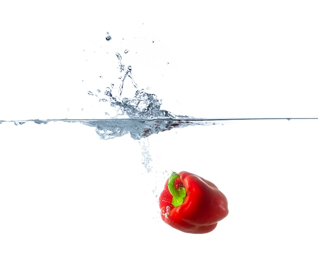 Red paprika sinking in water