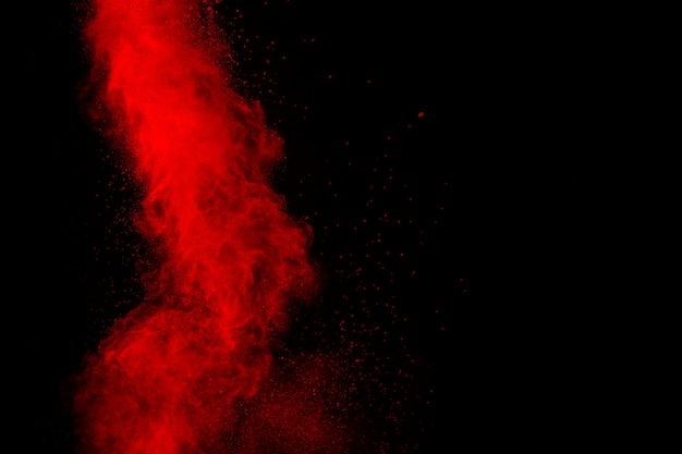 Red particles explosion on black.