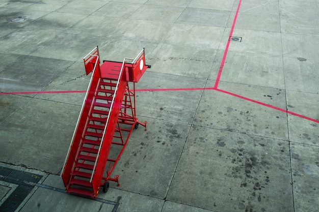 Red passenger step in the airport
