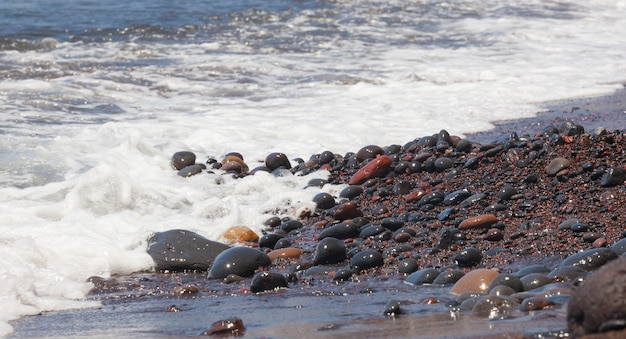 Red pebbles of the typical red beach of santorini