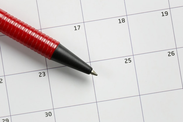Red pen pointing to twenty-fifth number of december.