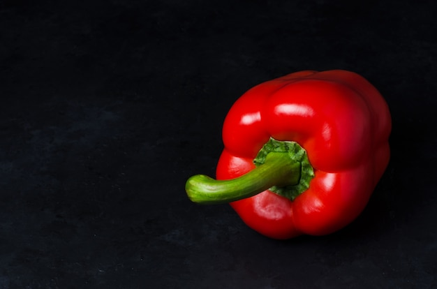 Red pepper on a black background. paprika. the species capsicum annuum. copy space