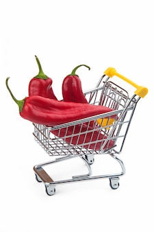 Red peppers in supermarket cart