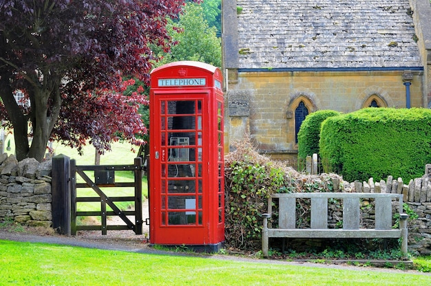 Red phone booth in the field