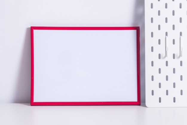 Red photo frame on white table