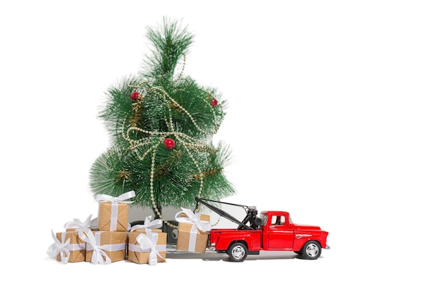 Red pickup car carrying a gift for the holiday on a white isolated background. new year and christmas concept