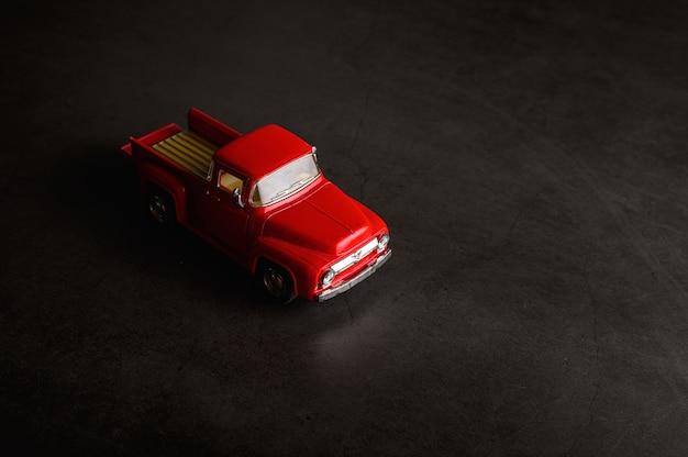 Red pickup model on the black floor