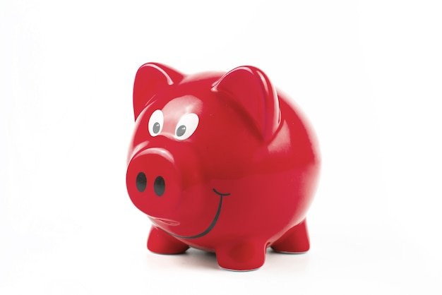 Red piggy bank on white background. finance savings and money wealth concept.