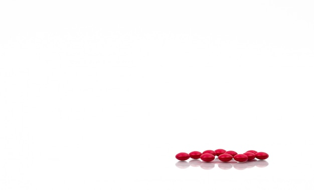 Red pills isolated on white background with copy space for text and clipping path