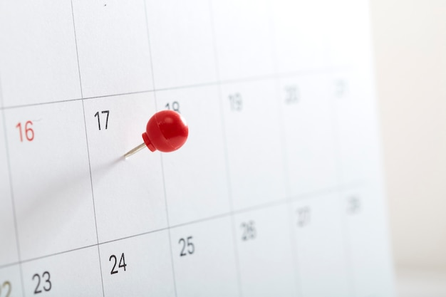 Red pin on calendar to remind