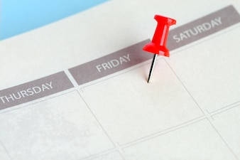 Red pin lace on friday of calendar in notebook