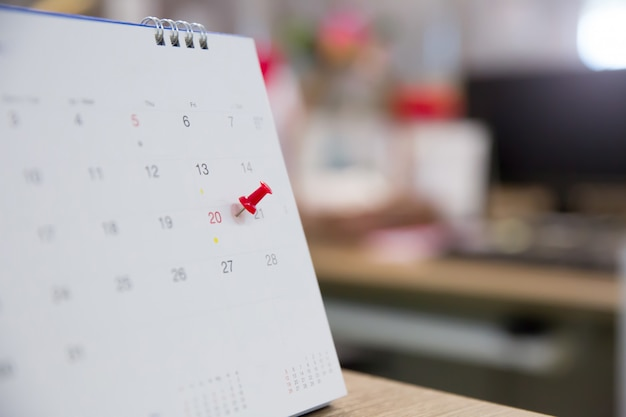 Red pin with calendar for event planner is busy
