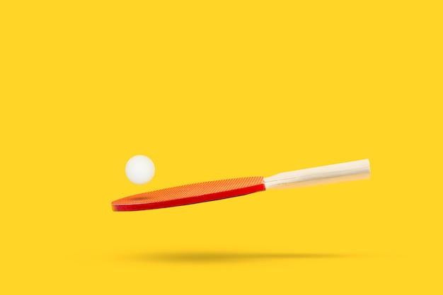 빨간색 탁구 패들과 노란색에 떠있는 흰색 공