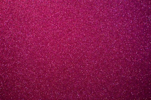 Red and pink background with sparkling festive glitter.