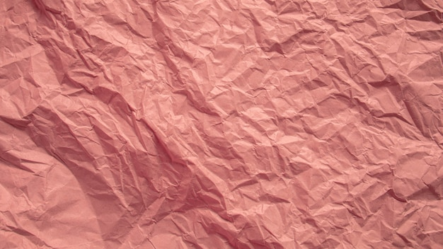 Red pink crumpled paper close up texture background